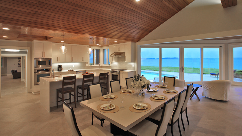 Dining room and kitchen of a renovated luxury modern home on the Maryland Eastern Shore