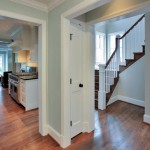 Doorways of renovated home in Arlington showing staircase and kitchen, Virginia
